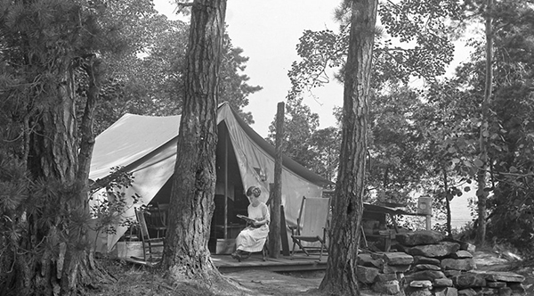 Woman Sitting at Tent