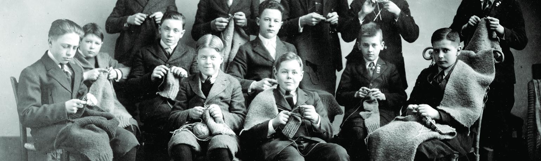 Boys Knitting for World War I Support